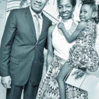 Prime Minister Andrew Holness with Niambe Tosh and daughter